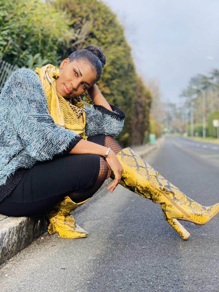 girl sitting on the street with justfab boot