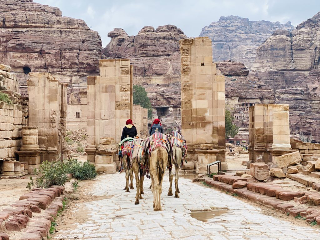 being on the camel after the monastery on colonnaded street petra